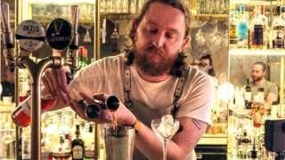 Calum O'Flynn serving a cocktail