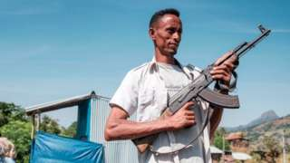 Amhara militia man with weapon