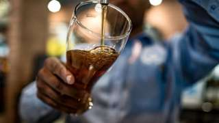 Barman pours a pint in Johannesburg