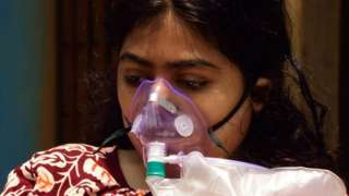 : Covid-19 patients wear medical oxygen masks outside a hospital before admission as pandemic situation has drastically deteriorated in the county in Kolkata, India on April 24, 2021.