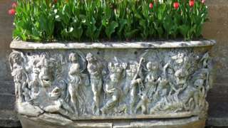 Plant pot / Roman sarcophagus in garden