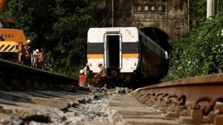 Rescuers remove parts of the train which derailed in a tunnel north of Hualien County, eastern Taiwan, 03 April 2021. According to news reports 51 people died and many others were injured when a train carrying 490 people derailed in a tunnel north of Hualien in eastern Taiwan on 02 April.