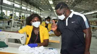 Ben Ayade for di garment factory with worker