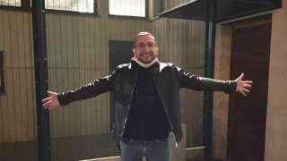 Сергей Савельев около депортационного центра в Париже
