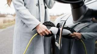 Woman plus in electric car
