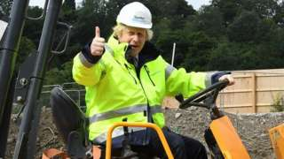 Boris Johnson on a digger during a visit to a construction site last month