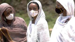 People wearing face masks as a precautionary measure against the coronavirus (Covid-19) come to Entoto Kidane Mehret Church as Ethiopian Orthodox Christians celebrate Filseta Day after the end of fasting for 15 days without consuming animal products in commemoration of Assumption of Mary in Addis Ababa, Ethiopia on August 22, 2020.