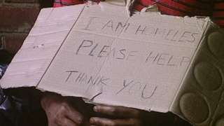 Homeless person's cardboard sign