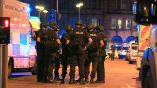 Armed Police officers at Manchester Arena