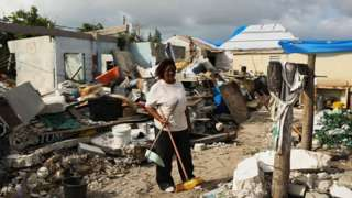 Flo Webber stands amongst the debris of her home on the nearly destroyed island of Barbuda which was nearly levelled when Hurricane Irma made landfall with 300km/h winds.