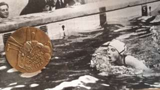 Lucy Morton and her gold medal