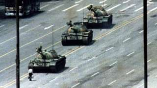 """A man known as """"tank man"""" stands in front of tanks in 1989"""
