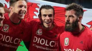 Gareth Bale (centre) with Wayne Hennessey and Joe Ledley
