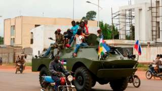 A Russian armoured personnel carrier (APC) is seen driving in the street during the delivery of armoured vehicles to the Central African Republic army in Bangu