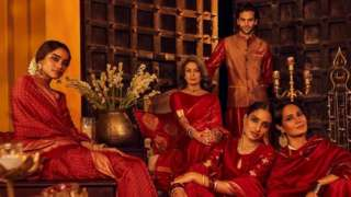 The ad featured models in traditional attire