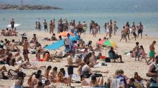 people on Tel Aviv beach