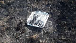 Disposable barbecue on burnt land