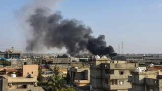 Smoke plumes coming out of buildings following airstrikes on Tajoura, south of Tripoli, on 29 June