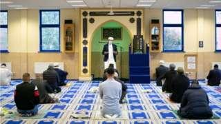 Imam Qari Asim during worship at the Makkah Masjid in Leeds