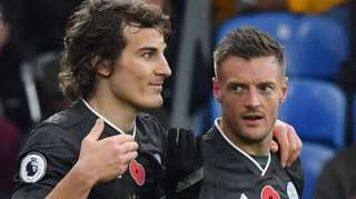 Caglar Soyuncu (left) and Jamie Vardy