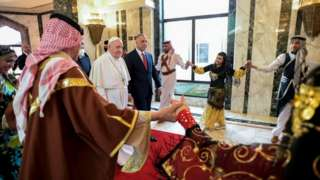 The Pope was greeted by Iraq's PM and dancers at the airport in Baghdad
