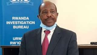 """Paul Rusesabagina, the man who was hailed a hero in a Hollywood movie about the country""""s 1994 genocide is detained and paraded in front of media in handcuffs at the headquarters of Rwanda Investigation Bureau in Kigali, Rwanda August 31, 2020"""