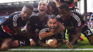 Nottingham Forest players celebrate Henri Lansbury's late equaliser against Aston Villa
