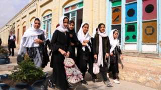 Afghan student girls arrive to attend lectures on the school in Herat, Afghanistan, on 6 March 2021