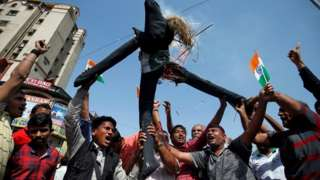 People burn an effigy depicting Pakistan as they celebrate after Indian authorities said their jets conducted airstrikes on militant camps in Pakistani territory, in Ahmedabad, India, February 26, 2019