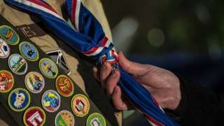 A scout receives their blue Eagle Scout neckerchief
