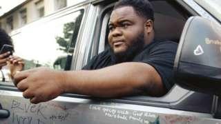 Micah Lammie sitting in car