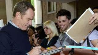Bryan Cranston signing autographs