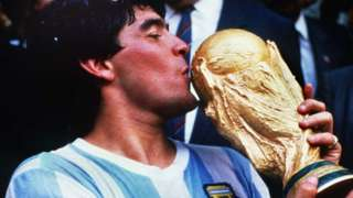 Diego Maradona kissing the World Cup after victory in 1986
