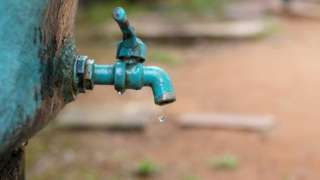 A water tap with a water drop