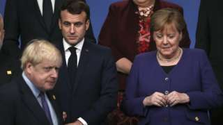 Prime Minister Boris Johnson (left) pictured with French president Emmanuel Macron and German Chancellor Angela Merkel in 2019