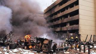 Firemen in action at the site of a huge bomb explosion that shook a bank building and US embassy in central Nairobi, Kenya, 07 August 1998