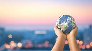 Toy Planet Earth being held in a child's hands