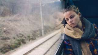 Woman on a train stock image