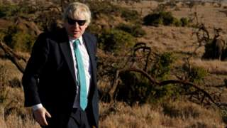 Boris Johnson watches elephants graze at the Lewa wildlife conservancy, sprawling over the Laikipia plains, in northern Kenya, on March 17, 2017