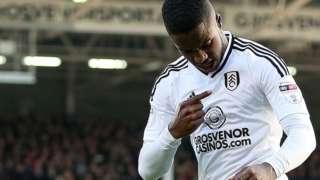 Ryan Sessegnon points to the Fulham badge as he celebrates his goal against Aston Villa