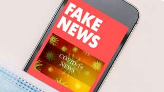 Mocked up image showing mobile phone with fake news text