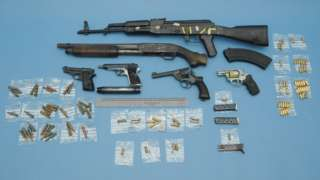 Guns and ammunition seized from a loft on Rylands Drive in Warrington