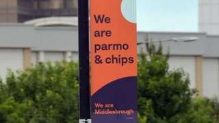 A banner saying 'we are parmo and chips'
