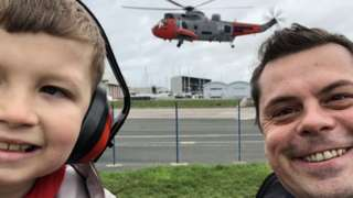 Finley Eckersley and dad with Sea King helicopter