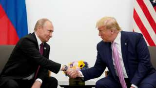 Russian President Vladimir Putin shakes hands with US President Donald Trump in 2019