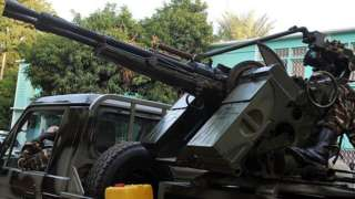 A armoured vehicle by the presidential palace in Niamey, Niger - archive shot