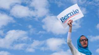 A supporter of Democratic presidential hopeful Vermont Senator Bernie Sanders (not pictured) holds up a sign