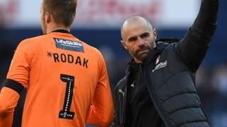 Rotherham goalkeeper Marek Rodak and manager Paul Warne