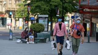 People wearing masks in Sheffield