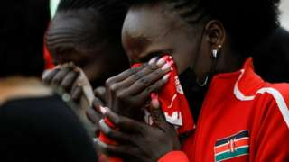 Kenyan athletes mourn during the funeral service of long-distance runner Agnes Tirop